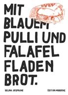 Selina Ursprung - Mit blauem Pulli und Falafel Fladenbrot.